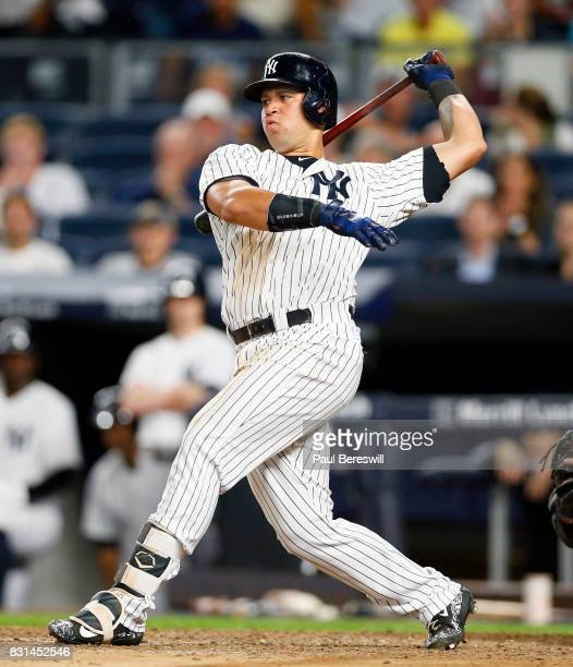 Gary Sanchez of the New York Yankees hits a single in an MLB baseball game against the Boston Red Sox on August 11 2017 at Yankee Stadium in the...