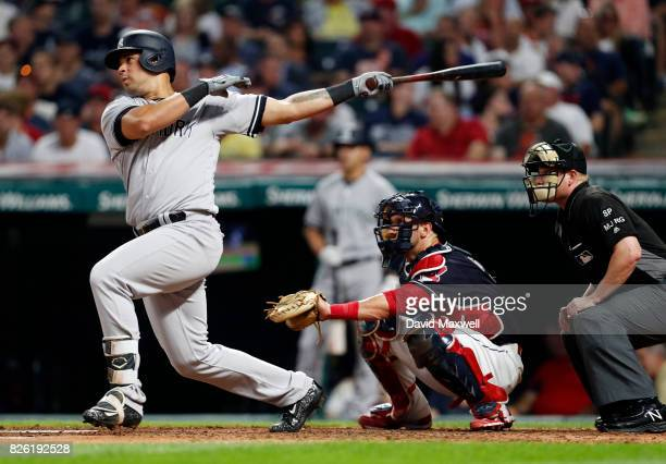 Gary Sanchez of the New York Yankees hits a solo home run against the Cleveland Indians in the seventh inning at Progressive Field on August 3 2017...