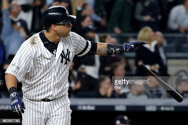 Gary Sanchez of the New York Yankees hits a solo home run during the seventh inning against the Houston Astros in Game Five of the American League...