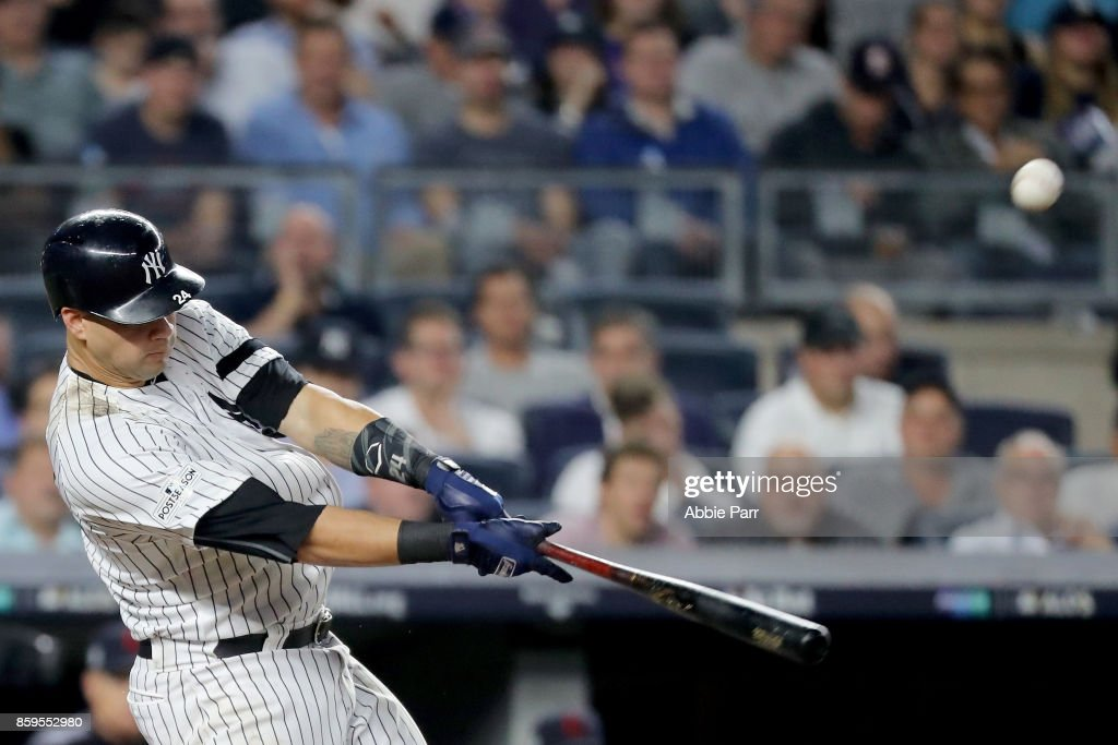 Gary Sanchez #24 of the New York Yankees hits a solo home run to right field against Bryan Shaw #27 of the Cleveland Indians during the seventh inning in Game Four of the American League Divisional Series at Yankee Stadium on October 9, 2017 in the Bronx borough of New York City.