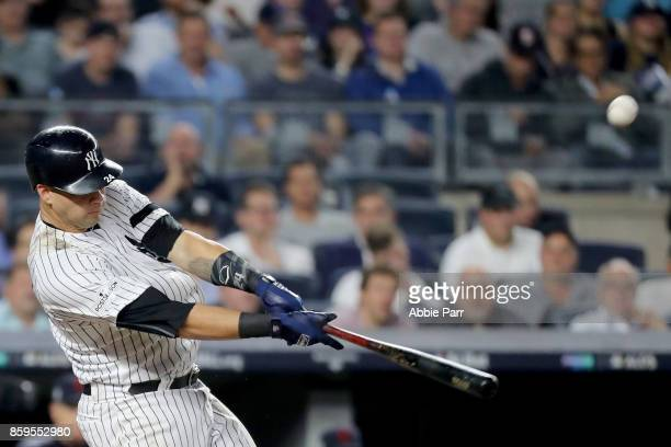 Gary Sanchez of the New York Yankees hits a solo home run to right field against Bryan Shaw of the Cleveland Indians during the seventh inning in...