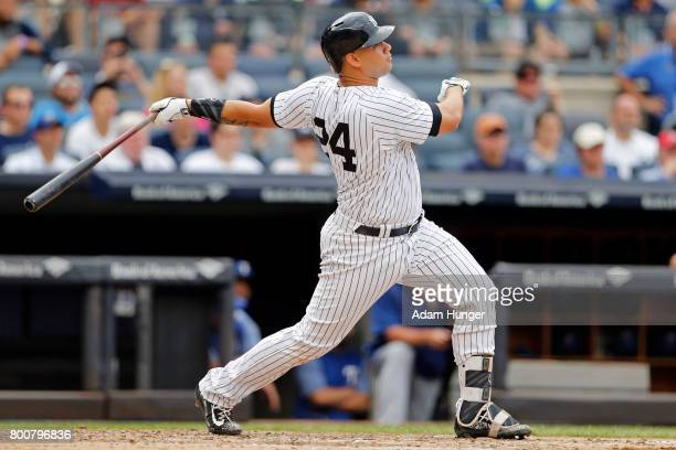 Gary Sanchez of the New York Yankees hits a threerun home run against the Texas Rangers during the fifth inning at Yankee Stadium on June 25 2017 in...