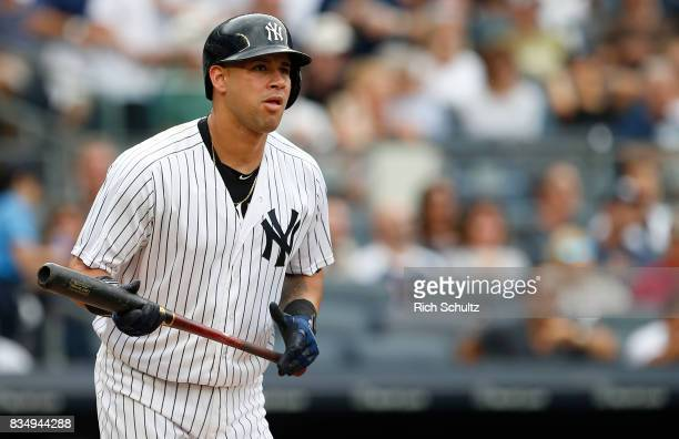 Gary Sanchez of the New York Yankees hits a tworun home run against the Boston Red Sox during the first inning of a game at Yankee Stadium on August...