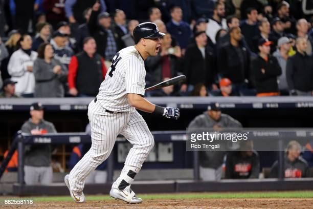Gary Sanchez of the New York Yankees hits an RBI double in the eighth inning during Game 4 of the American League Championship Series against the...