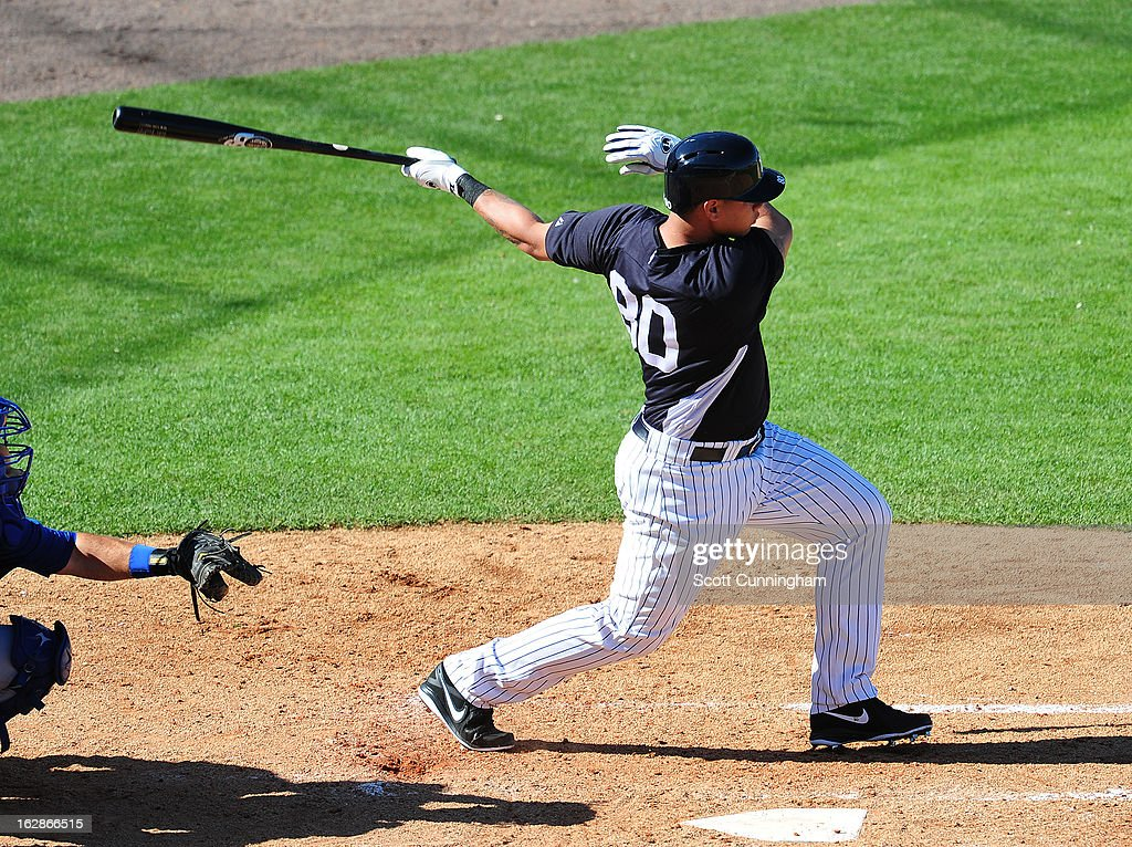 Gary Sanchez #80 of the New York Yankees hits during the spring training game against the Toronto Blue Jays at George M. Steinbrenner Field on February 28, 2013 in Tampa, Florida.