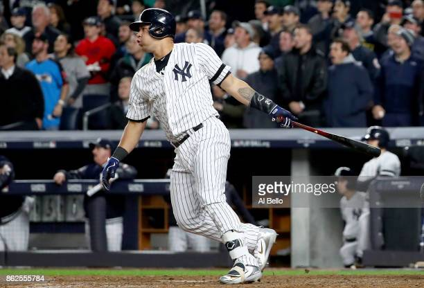 Gary Sanchez of the New York Yankees htis a tworun goahead double during the eighth inning against the Houston Astros in Game Four of the American...