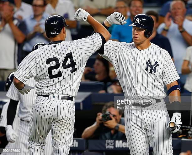 Gary Sanchez of the New York Yankees is congratulated by Aaron Judge after he hit a home run against the Toronto Blue Jays during the second inning...
