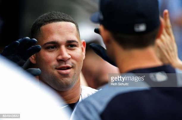 Gary Sanchez of the New York Yankees is congratulated by tteammates after he hit a tworun home run against the Boston Red Sox during the first inning...