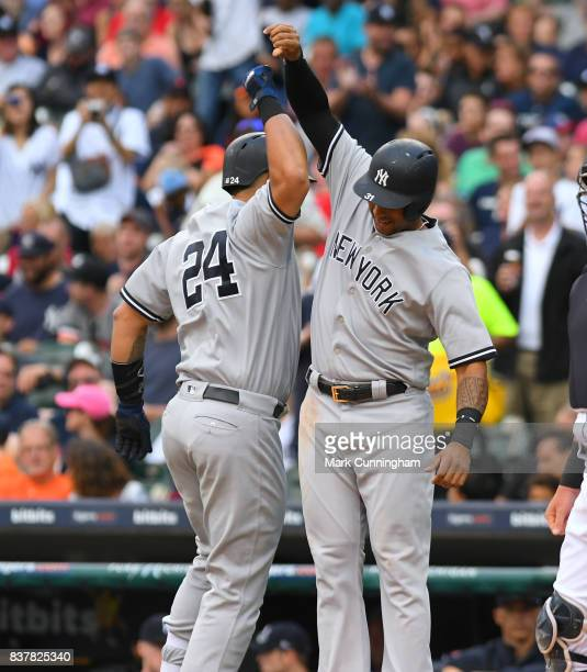 Gary Sanchez of the New York Yankees is greeted at home plate by teammate Aaron Hicks after hitting a tworun home run in the first inning of the game...