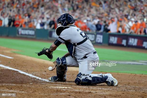 Gary Sanchez of the New York Yankees misses a catch at the plate to score Yuli Gurriel during the eighth inning in Game Six of the American League...