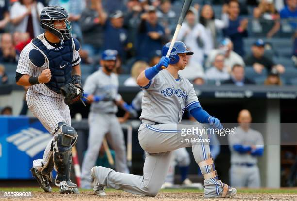 Gary Sanchez of the New York Yankees reacts after Justin Smoak of the Toronto Blue Jays strikes out to end the eighth inning at Yankee Stadium on...