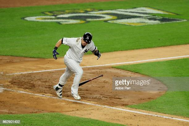 Gary Sanchez of the New York Yankees reacts as he hits a single scoring Aaron Judge during the fifth inning against the Houston Astros in Game Five...