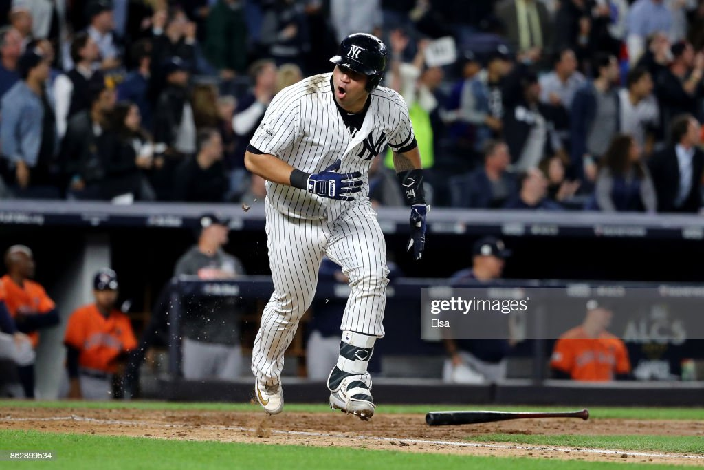 Gary Sanchez #24 of the New York Yankees reacts as he hits a single during the fifth inning scoring Chase Headley #12 against the Houston Astros in Game Five of the American League Championship Series at Yankee Stadium on October 18, 2017 in the Bronx borough of New York City.