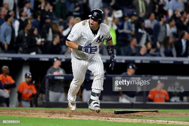 Gary Sanchez of the New York Yankees reacts as he hits a single during the fifth inning scoring Chase Headley against the Houston Astros in Game Five...