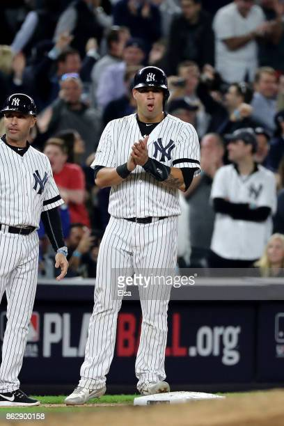 Gary Sanchez of the New York Yankees reacts on third base after a run during the fifth inning against the Houston Astros in Game Five of the American...