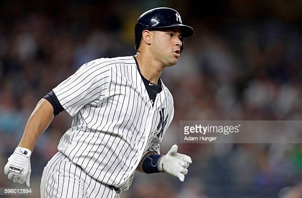 Gary Sanchez of the New York Yankees rounds first base on a 2RBI double during the second inning against the Baltimore Orioles at Yankee Stadium on...