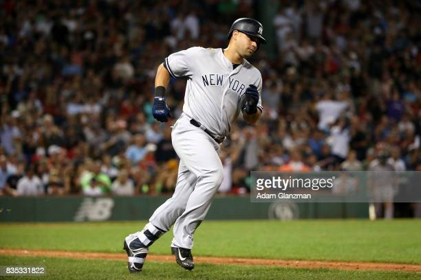 Gary Sanchez of the New York Yankees rounds the bases after hitting a solo home run in the seventh inning of a game against the Boston Red Sox at...