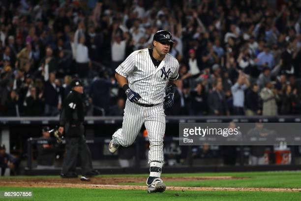 Gary Sanchez of the New York Yankees rounds the bases after hitting a solo home run during the seventh inning against the Houston Astros in Game Five...