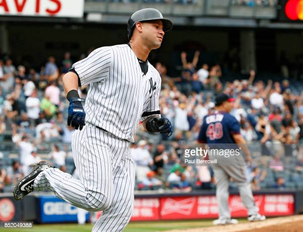 Gary Sanchez of the New York Yankees runs the bases after hitting a home run in an MLB baseball game against the Minnesota Twins as Bartolo Colon...