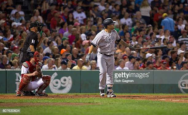 Gary Sanchez of the New York Yankees watches his home run leave the park during the third inning against the Boston Red Sox at Fenway Park on...