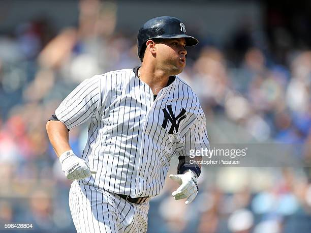 Gary Sanchez of the New York Yankees watches his solo homerun in the bottom of the fourth inning against the Baltimore Orioles on August 27 2016 at...