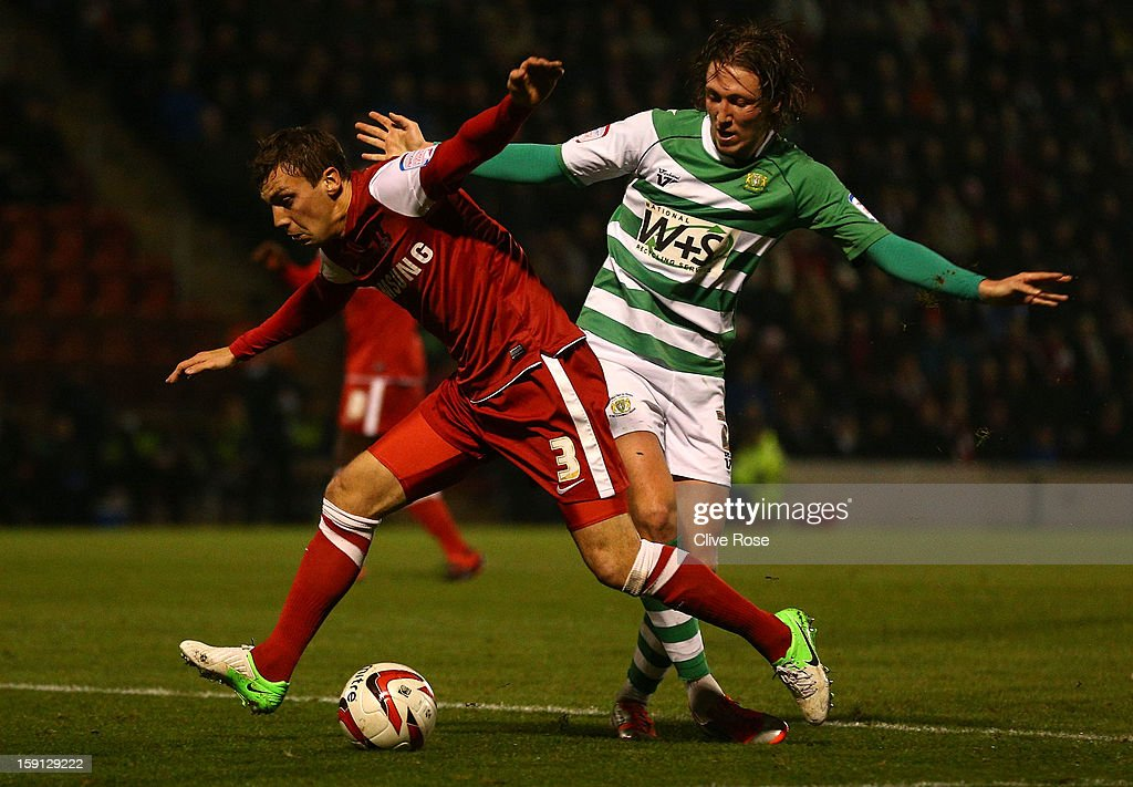 Gary Sawyer of Leyon Orient is challenged by Luke Ayling of Yeovil Town during the Johnstone's Paint Trophy southern section semi final between Leyton Orient and Yeovil Town at the Matchroom Stadium on January 8, 2013 in London, England.