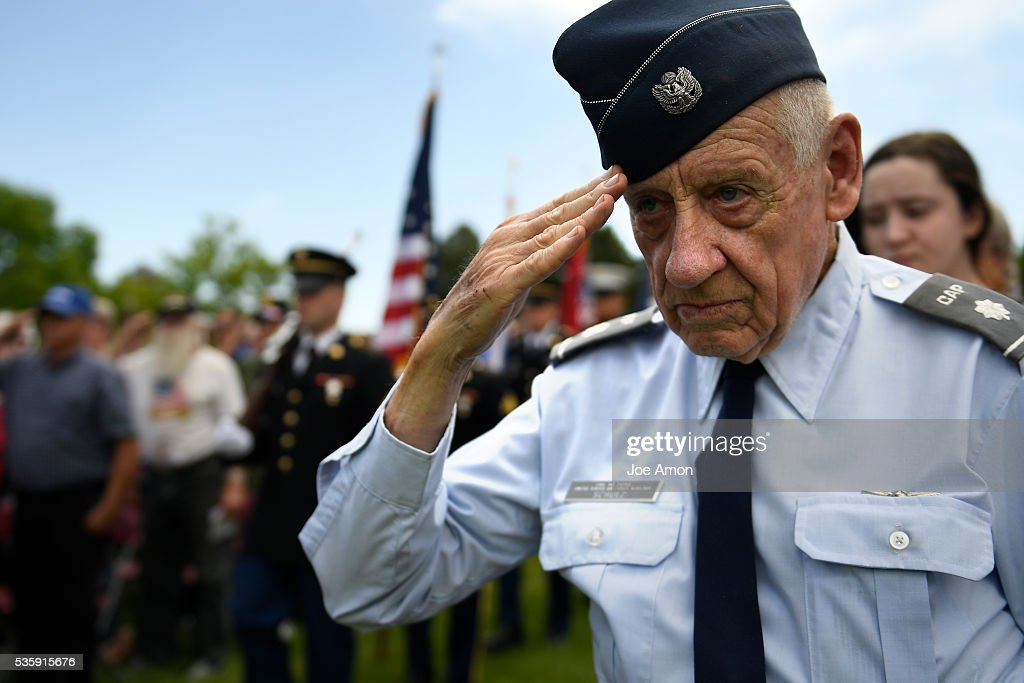 Gary Schulz, US Air Force 59-63 and the Civil Air Patrol salutes as the Aerospace Data Facility Joint Color Guard present the Colors at the Memorial Day ceremony, 84th Anniversary of Remembrance at Fort Logan National Cemetery. May 30, 2016 in Denver, CO.