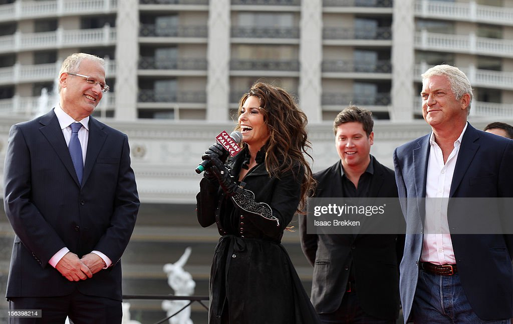 Gary Selesner, Caesars Palace regional president, (L) and John Meglen, president and CEO of AEG Live/Concerts West (R) welcome international superstar Shania Twain and her manager Jason Owen to Caesars Palace on November 14, 2012 in Las Vegas, Nevada.