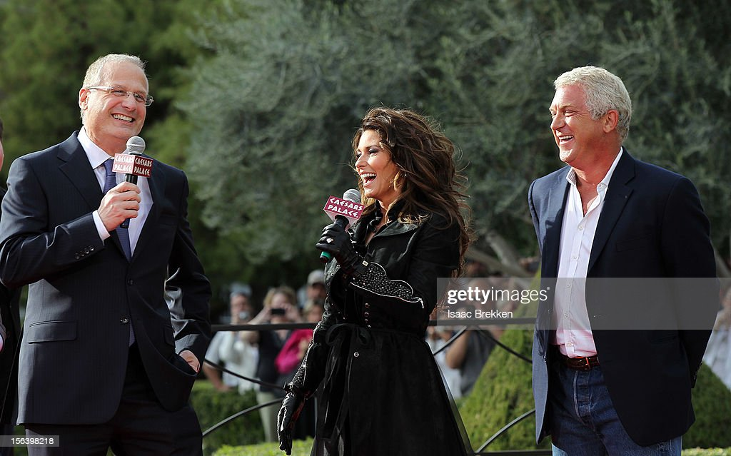 Gary Selesner, Caesars Palace regional president, (L) and John Meglen, president and CEO of AEG Live/Concerts West (R) welcome international superstar Shania Twain to Caesars Palace on November 14, 2012 in Las Vegas, Nevada.