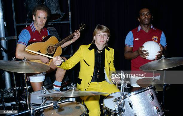 Gary Shaw of Aston Villa playing the drums meets Showaddywaddy pop stars Romeo Challenger and Trevor Oaskes circa 1982
