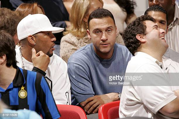 Gary Sheffield and Derek Jeter of the New York Yankees watch the Miami Heat play against the Seattle SuperSonics January 3 2005 at American Airlines...