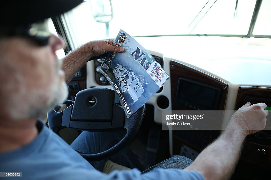 Gary Shelton holds a brochure for a tow-able RV as he inspects a motorhome at Cordelia RV on May 29, 2013 in Fairfield, California. Deliveries of motor homes and towable RVs to dealers surged 11 percent in the first quarter and the RV industry anticipates a total of 307,300 units will be shipped this year, the highest number since 2007.