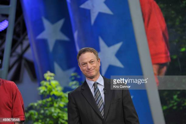 Gary Sinise performs during the rehearsal of the 25th Anniversary Broadcast Of The National Memorial Day Concert at US Capital West Lawn on May 24...