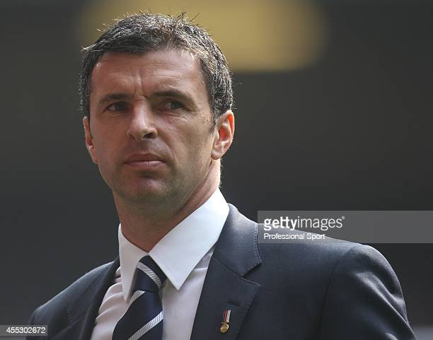 Gary Speed the manager of Wales watching the UEFA EURO 2012 Group G qualifying match between Wales and England at the Millennium Stadium on March 26...