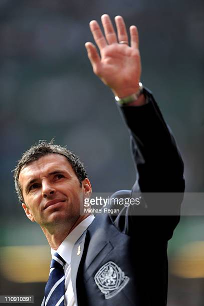 Gary Speed the manager of Wales waves to the fans prior to kickoff during the UEFA EURO 2012 Group G qualifying match between Wales and England at...