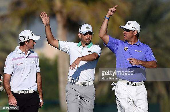 Gary Stal of France chatting with Sergio Garcia of Spain and Lee Westwood of England on the par five 13th hole during the first round of the Omega...