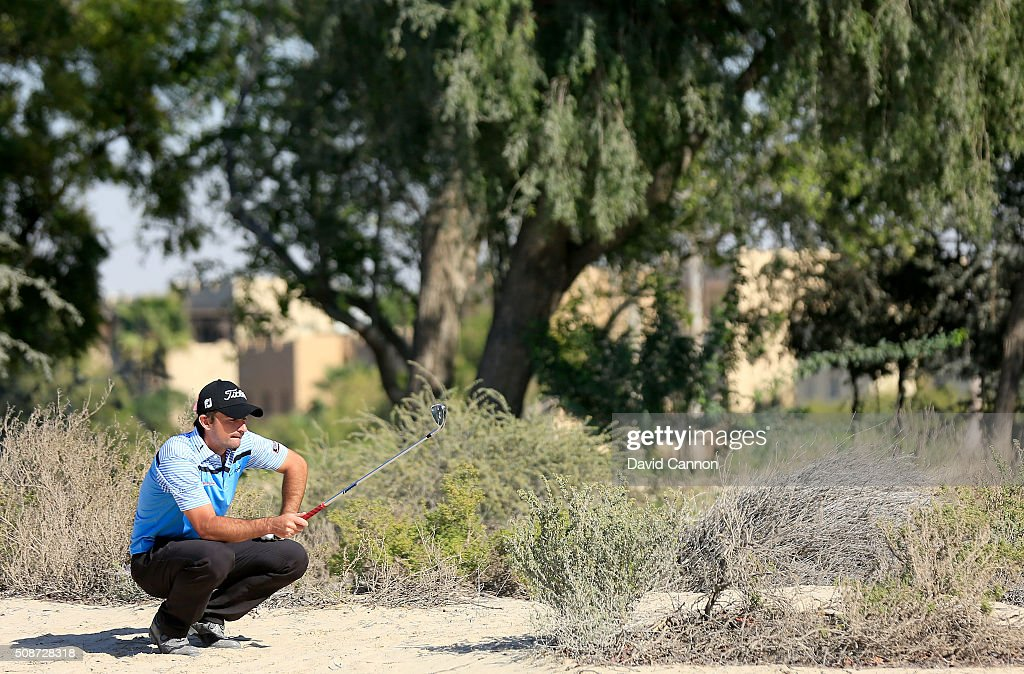 Gary Stal of France decides how to play his second shot at the par 4, 14th hole during the third round of the 2016 Omega Dubai Desert Classic on the Majlis Course at the Emirates Golf Club on February 6, 2016 in Dubai, United Arab Emirates.