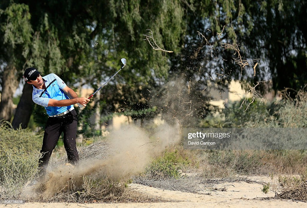 Gary Stal of France plays his second shot at the par 4 14th hole during the third round of the 2016 Omega Dubai Desert Classic on the Majlis Course...