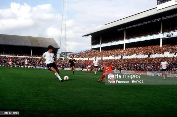 Gary Stevens of Tottenham Hotspur controls the ball as Nottingham Forest's Ian Wallace stumbles