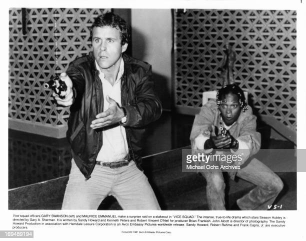 Gary Swanson and Maurice Emanuel point their guns in a scene from the film 'Vice Squad' 1982