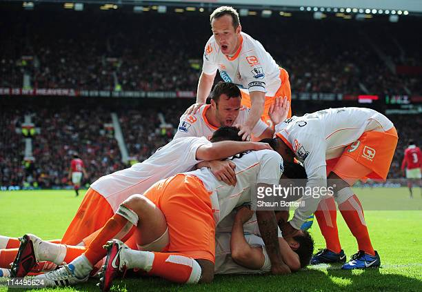 Gary TaylorFletcher of Blackpool celebrates with team mates as he scores their second goal during the Barclays Premier League match between...
