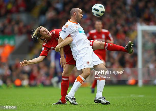 Gary TaylorFletcher of Blackpool holds off a challenge from Christian Poulsen during the Barclays Premier League match between Liverpool and...