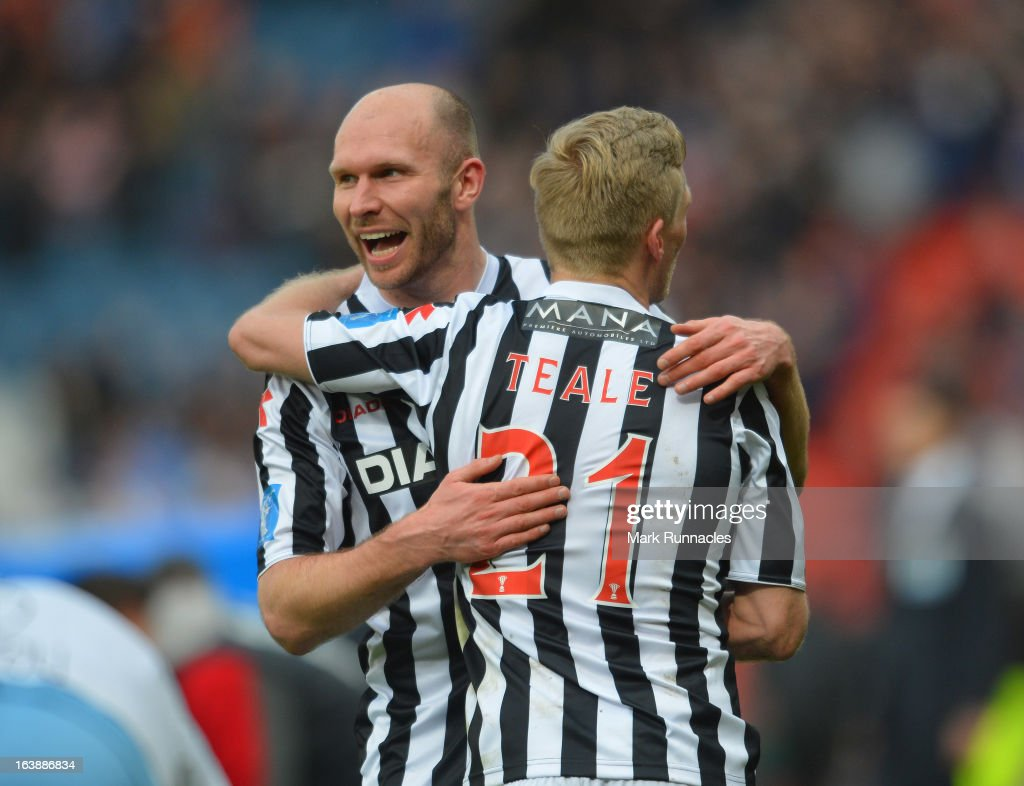 Gary Teale and Sam Parkin of St Mirren celebrates after his side triumphs in the Scottish Communities League Cup Final between St Mirren and Hearts at Hampden Park on March 17, 2013 in Glasgow, Scotland.
