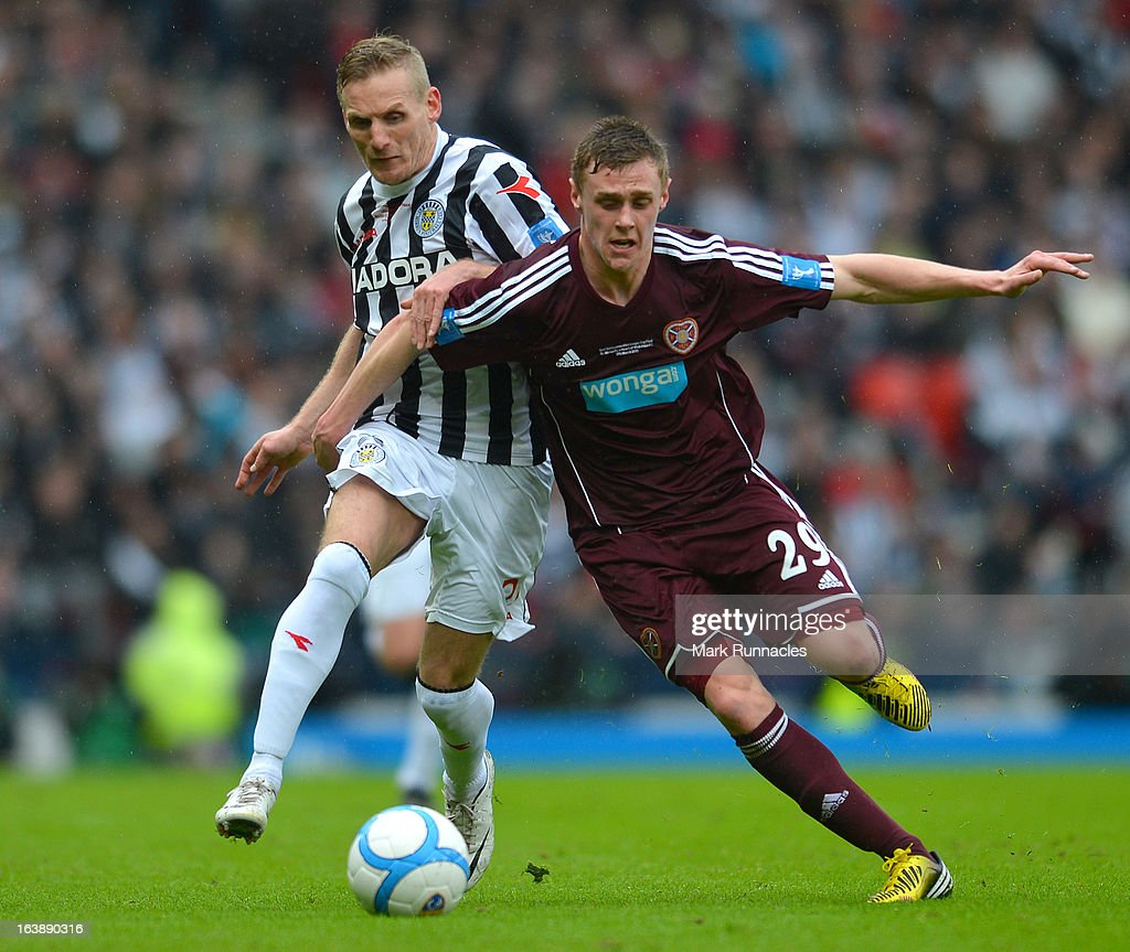 Gary Teale of St Mirren and Kevin McHattie of Hearts during the Scottish Communities League Cup Final between St Mirren and Hearts at Hampden Park on March 17, 2013 in Glasgow, Scotland.