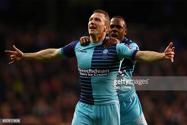 Gary Thompson of Wycombe Wanderers celebrates with Myles Weston of Wycombe Wanderers after scoring his sides third goal during the Emirates FA Cup...