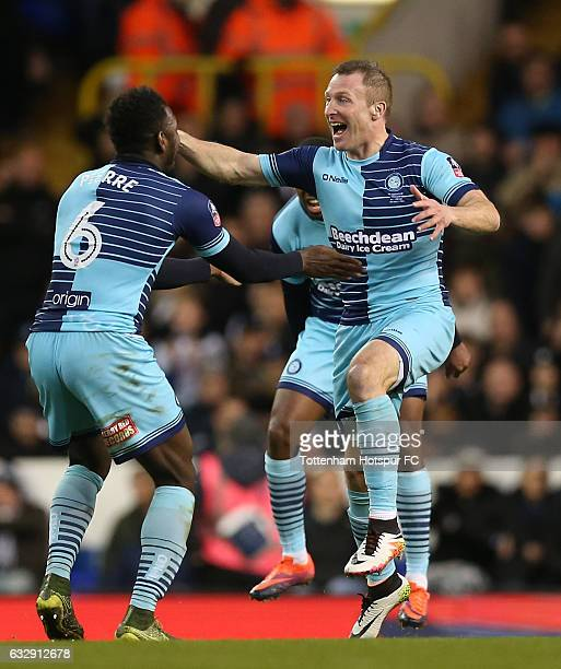 Gary Thompson of Wycombe Wanderers celebrates with team mates after scoring his sides third goal during the Emirates FA Cup Fourth Round match...