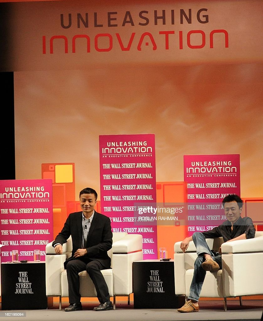 Gary Wang (R), founder of Tudou.com and Michael Anti, journalist, political commentator and microblogger attend the Wall Street Journal Unleashing Innovation executive conference held at Capella Singapore, Sentosa Island in Singapore on February 20, 2013. The conference which is the being held for the first time from February 19-21 in Singapore is attended by global leaders from business, government and academia with expertise in information technology, biotechnology and clean tech, to provide practical advice on strategies to drive innovation in organisations.