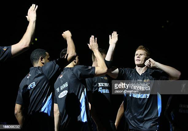 Gary Wilkinson of the Breakers highfives his teammates before the NBL Rd 6 match between New Zealand and Adelaide at Vector Arena on November 15 2013...