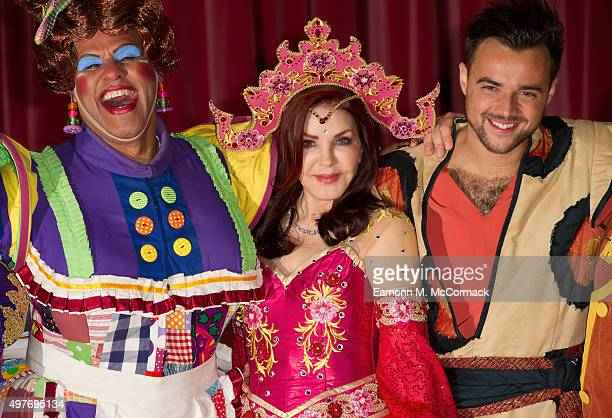 Gary Wilmott Priscilla Presely and Ben Adams pose during a photocall for 'Aladdin' at Milton Keynes Theatre on November 18 2015 in Milton Keynes...