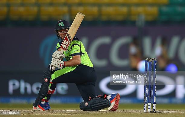 Gary Wilson of Ireland sweeps the ball towards the boundary during the ICC Twenty20 World Cup match between Ireland and Oman at the HPCA Stadium on...